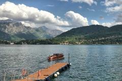 Tremezzo-attracco-barca-Lago-di-Como-nuvole